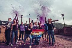 Volters with flag, signs and purple powder