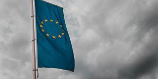 EU-flag under cloudy sky