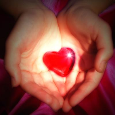 Red heart hold in hands
