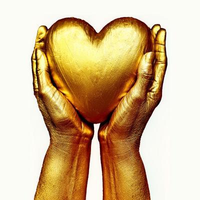 golden heart held in hands